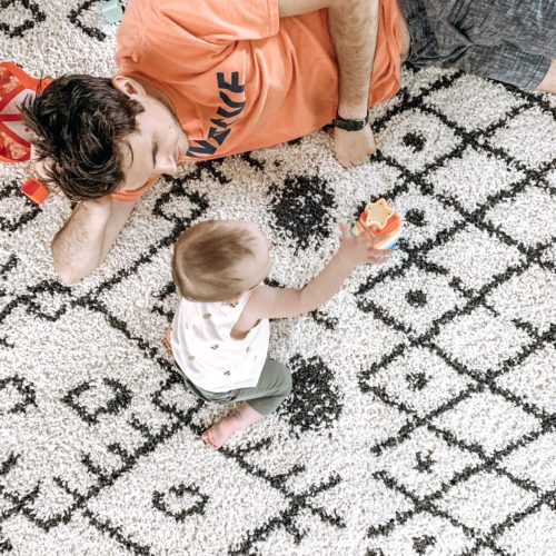 father-daughter-on-cozy-rug